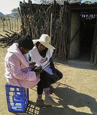 Fieldworker collects data with a tablet